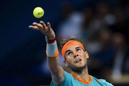 Rafael Nadal of Spain serves a ball during the Swiss Indoors ATP 500 tennis tournament on October 20, 2014 in Basel (AFP Photo/Fabrice Coffrini)