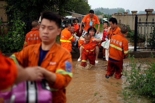 PHOTO: Rescue workers help residents stranded by floodwaters following heavy rainfall in Zhengzhou, Henan province, China July 23, 2021. (Aly Song/Reuters, FILE)