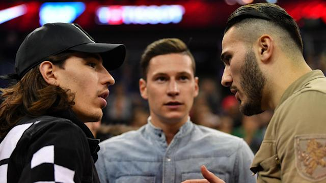 Paris Saint-Germain's Julian Draxler had to play it cool as Sead Kolasinac and Shkodran Mustafi tried to lure him to Arsenal on Thursday.