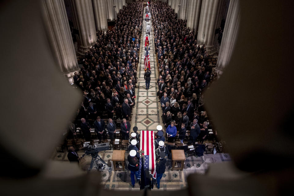 The flag-draped casket of former President George H.W. Bush is carried by a military honor guard during a State Funeral at the National Cathedral, Wednesday, Dec. 5, 2018, in Washington. (Photo: Andrew Harnik, Pool/AP)