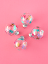 """<p>Dress up ordinary plastic ornaments with colorful vinyl snowflakes. Use a craft punch to create the shapes, and easily transfer them on to the ornaments to add a pop of color to your tree.</p><p><a href=""""https://www.whitehousecrafts.net/post/2018/12/02/mini-diy-colourful-vinyl-snowflake-ornaments"""" rel=""""nofollow noopener"""" target=""""_blank"""" data-ylk=""""slk:Get the tutorial at White House Crafts"""" class=""""link rapid-noclick-resp""""><em>Get the tutorial at White House Crafts</em></a></p>"""