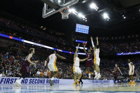 Mar 22, 2019; Columbus, OH, USA; Colgate Raiders guard Jordan Burns (1) shoots the ball over Tennessee Volunteers forward Grant Williams (2) in the second half in the first round of the 2019 NCAA Tournament at Nationwide Arena. Mandatory Credit: Rick Osentoski-USA TODAY Sports