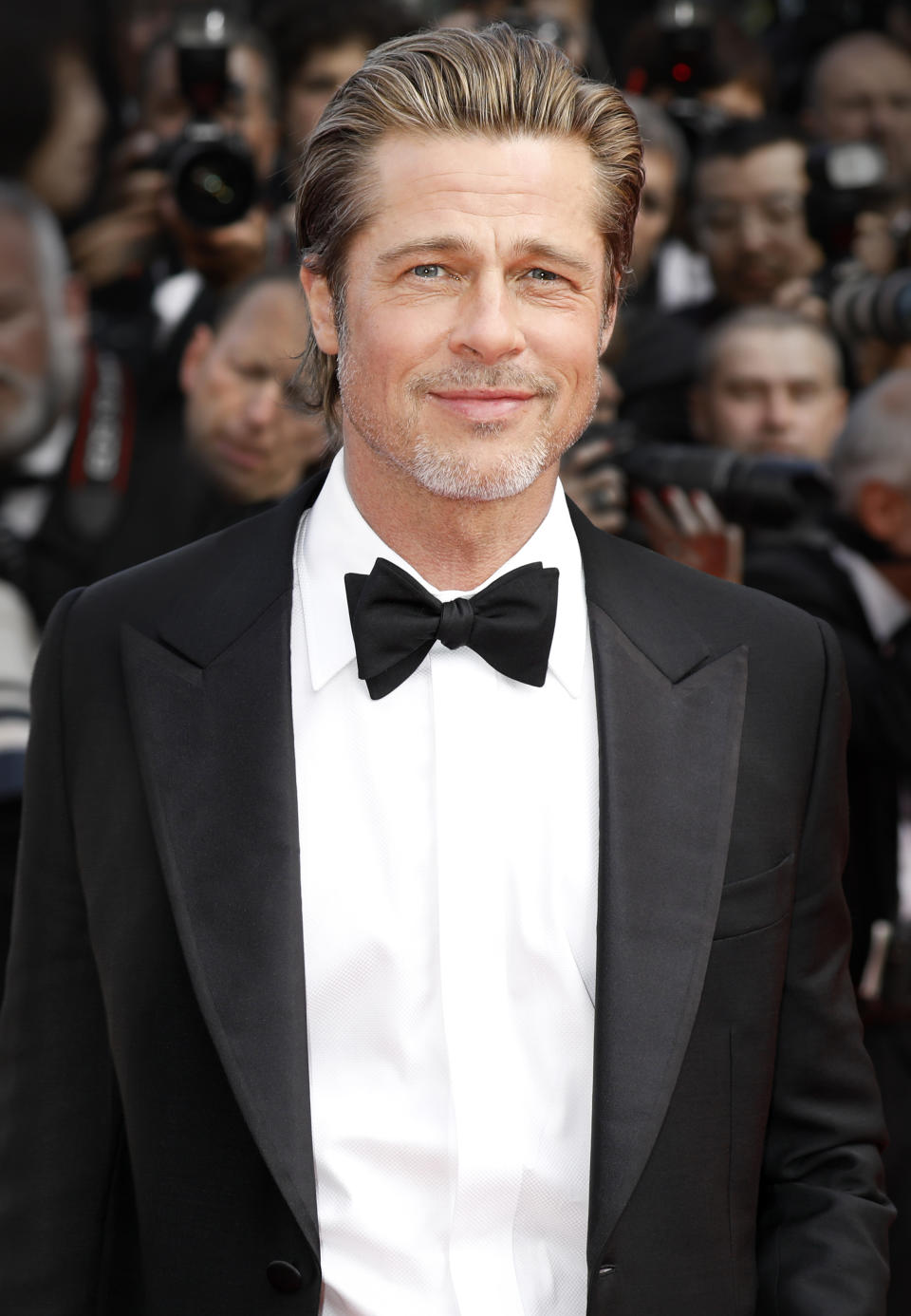 CANNES, FRANCE - MAY 21: (EDITORS NOTE: Image has been digitally retouched) Brad Pitt attends the premiere of 'Once Upon A Time In Hollywood' during the 72nd Cannes Film Festival at the Palais des Festivals on May 21, 2019 in Cannes, France.  (Photo by Kurt Krieger/Corbis via Getty Images)