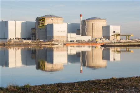 Greenpeace activists display an anti-nuclear banner after entering a nuclear power plant operated by EDF in Fessenheim