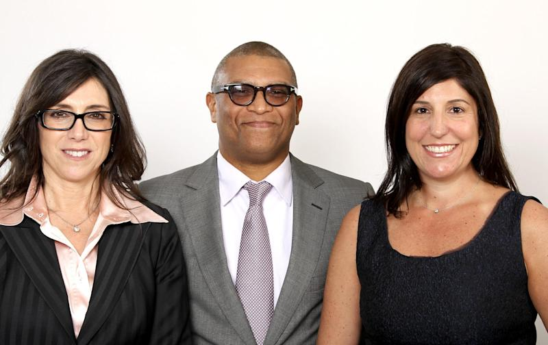 """FILE - This Feb. 4, 2013 file photos shows Oscar nominated producers Stacey Sher, left, Reginald Hudlin, center, and Pilar Savone at the 2013 Oscar Nominee Luncheon in Los Angeles. The three are nominated for the film, """"Django Unchained."""" (Photo by Matt Sayles/Invision/AP, file)"""