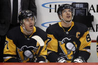Pittsburgh Penguins' Evgeni Malkin (71) and Sidney Crosby (87) watch a replay of a goal by Malkin during the first period of the team's NHL hockey game against the Minnesota Wild in Pittsburgh, Tuesday, Jan. 14, 2020. (AP Photo/Gene J. Puskar)