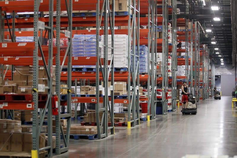 Shelves are stacked with merchandise at a Wal-Mart Stores Inc company distribution center in Bentonville, Arkansas in this June 6, 2013 file photo. REUTERS/Rick Wilking/Files