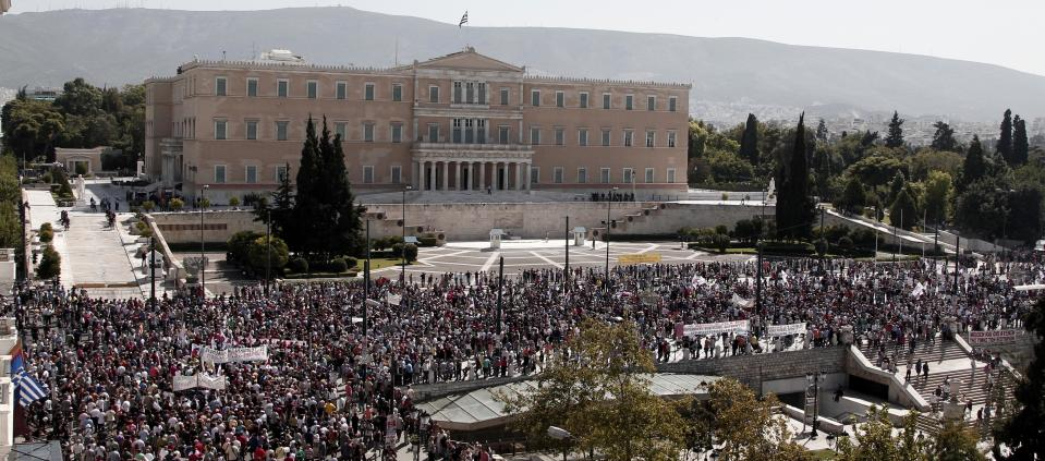 Protesters of the Greek Communist party affiliated unions march in front of the Greek Parliament in Athens Wednesday Sept. 26, 2012. Greek workers walked off the job Wednesday for the first general strike since the country's coalition government was formed in June, as the prime minister and finance minister hammered out a package of euros 11.5 billion ($14.87 billion) in spending cuts. (AP Photo/Dimitri Messinis)