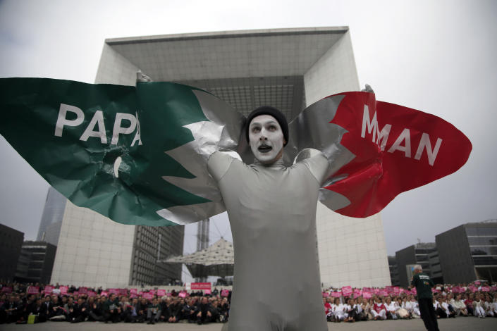 """FILE - In this file photo taken on Tuesday Oct. 23, 2012, a man dressed as a bird performs during an anti-gay marriage demonstration in Paris, Tuesday, Oct. 23, 2012. A plan to legalize same-sex marriage and allow gay couples to adopt was a liberal cornerstone of French President Francois Hollande's election manifesto earlier this year. It looked like a shoo-in, supported by a majority of the French, and an easy way to break with his conservative predecessor. But that was then, Now, as the Socialist government prepares to unveil its draft """"marriage for everyone"""" law Wednesday, polls show wavering support for the idea and for the president amid increasingly vocal opposition in this traditionally Catholic country. (AP Photo/Christophe Ena, File)"""