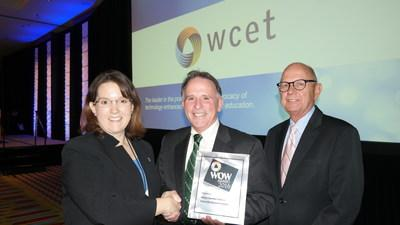 WGU VP of Financial Aid Bob Collins (center), and WGU CFO David Grow (right), receive a WOW award from Kara Monroe, Chair of the 2016 WCET Awards Committee in Minneapolis, MN.