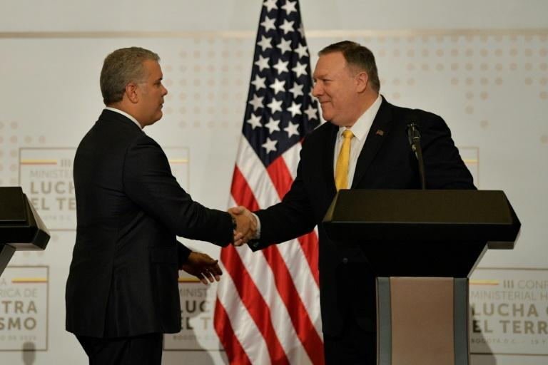 US Secretary of State Mike Pompeo (right) shakes hands with Colombia President Ivan Duque as the two meet in Bogota to discuss the humanitarian crisis in Venezuela
