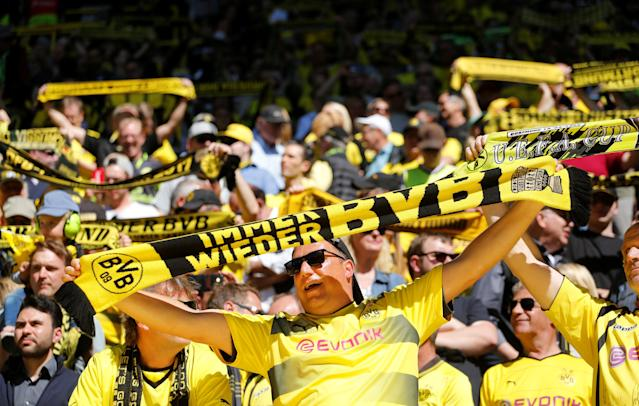 Soccer Football - Bundesliga - Borussia Dortmund vs 1.FSV Mainz 05 - Signal Iduna Park, Dortmund, Germany - May 5, 2018 Borussia Dortmund fans before the match REUTERS/Leon Kuegeler DFL RULES TO LIMIT THE ONLINE USAGE DURING MATCH TIME TO 15 PICTURES PER GAME. IMAGE SEQUENCES TO SIMULATE VIDEO IS NOT ALLOWED AT ANY TIME. FOR FURTHER QUERIES PLEASE CONTACT DFL DIRECTLY AT + 49 69 650050