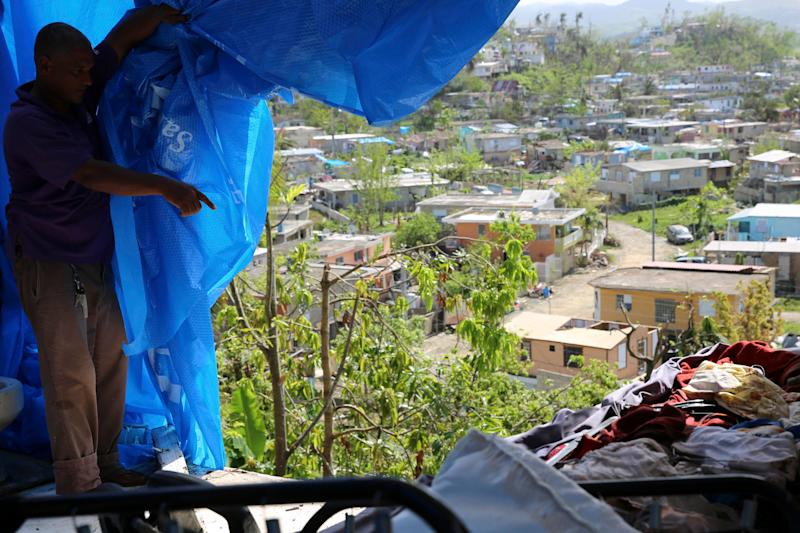 Danny Guerrero Herrera in mid-October shows HuffPost what's behind the blue tarp a charitable organization gave him after Hurricane Maria's winds ripped away most of his home's roof and several walls in Canóvanas, Puerto Rico.
