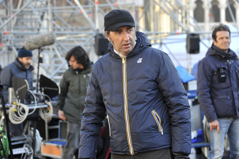 "FILE - This Jan. 12, 2016 file photo shows Italian director Paolo Sorrentino on the set of his TV series ""The Young Pope"", featuring actor Jude Law, in Venice's St. Mark's Square in Italy. The 10-episode series premieres Sunday, Jan. 15, 2017 on HBO. (AP Photo/Luigi Costantini, File)"