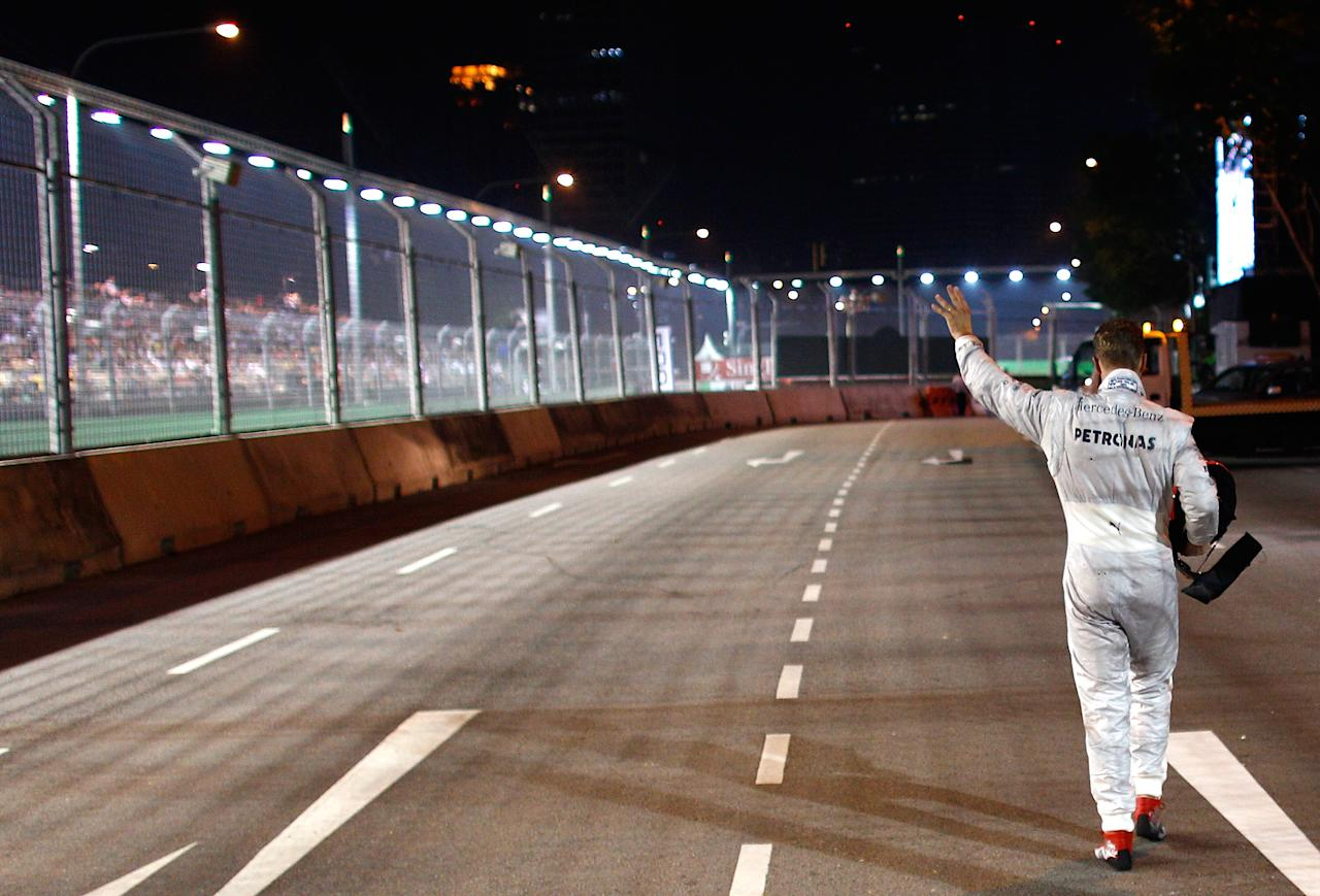 SINGAPORE , SINGAPORE - SEPTEMBER 23:  Michael Schumacher of Germany and Mercedes GP is pictured after his crash during the Formula One Grand Prix of Singapore at Marina Bay Street Circuit on September 23, 2012 in Singapore, Singapore.  (Photo by Vladimir Rys Photography/Getty Images)