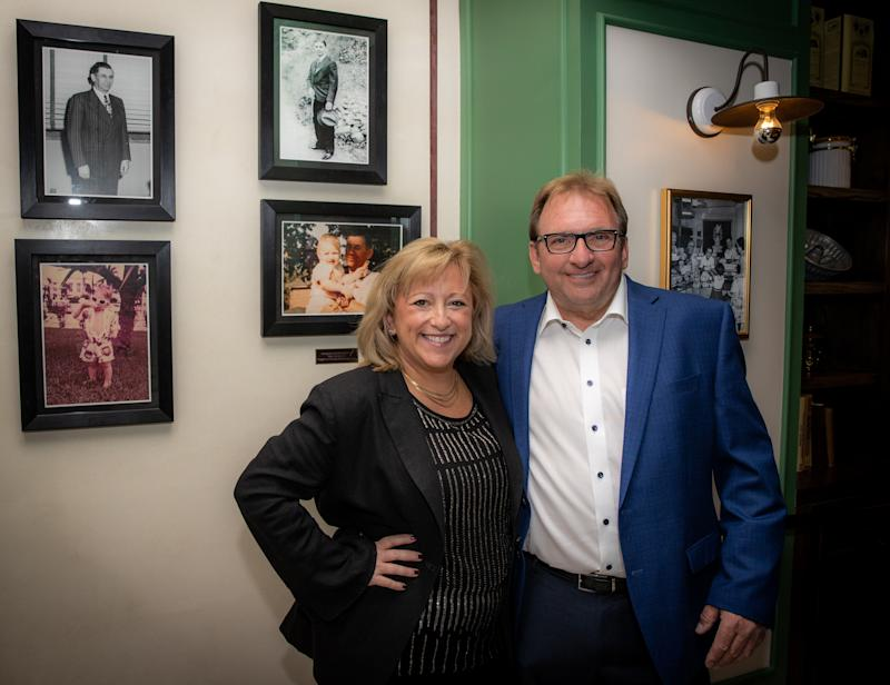 Flamingo Las Vegas founder Meyer Lansky's grandson, Meyer Lansky II and wife Dani, in front of historical family photos, seen upon entering Bugsy & Meyer's Steakhouse.