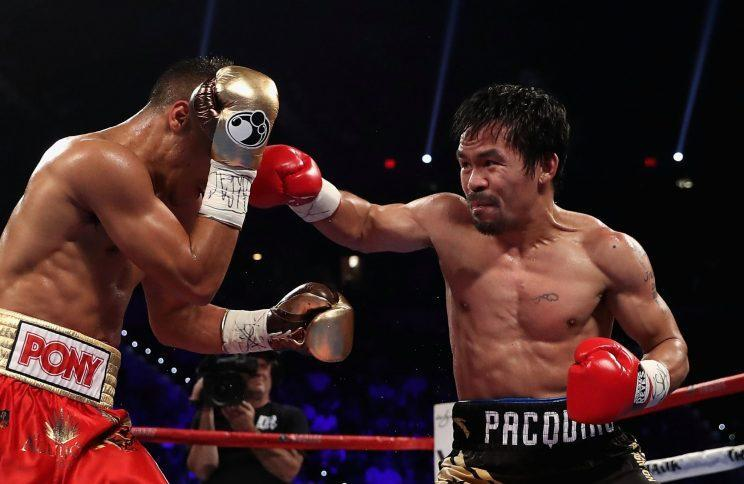 Manny Pacquiao (R), shown on Nov. 5 in a win over Jessie Vargas, has interest in fighting UFC star Conor McGregor, but does not plan to fight four times this year as his promoter had said. (Getty Images)