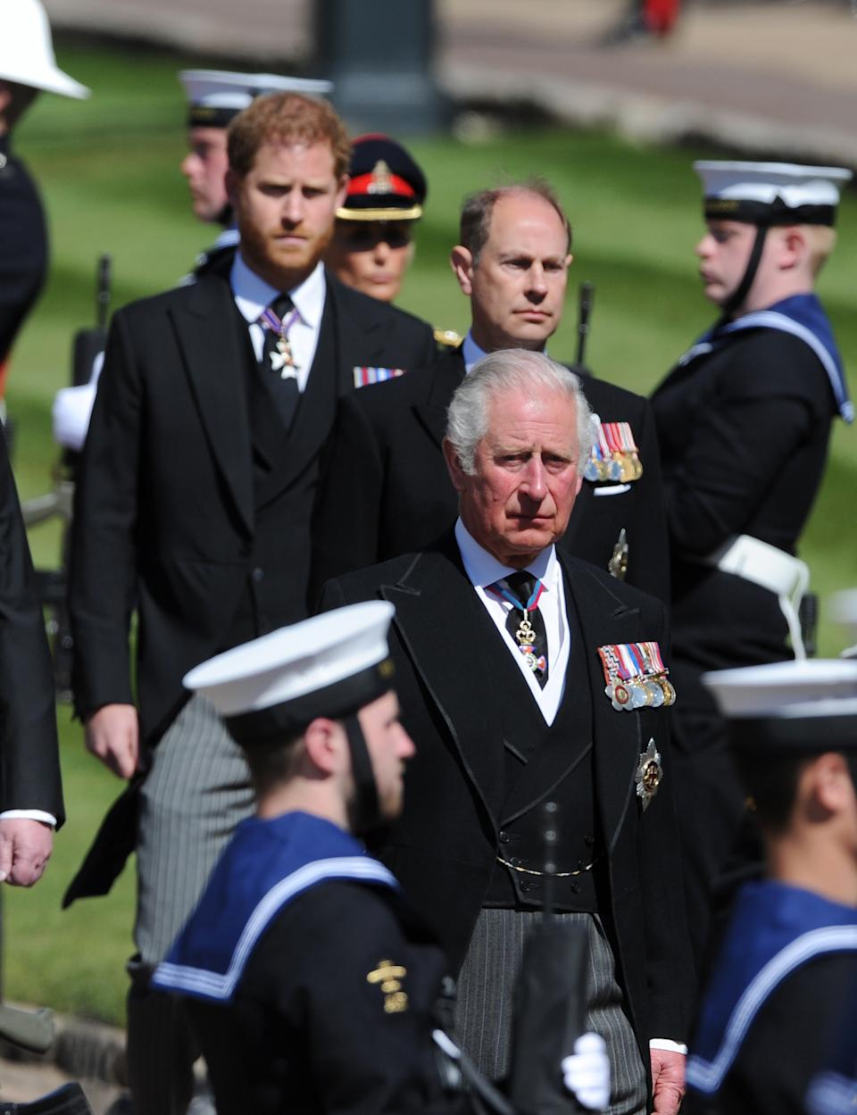 Prince Charles, Prince of Wales and other royal family members walk behind The Duke of Edinburgh's coffin