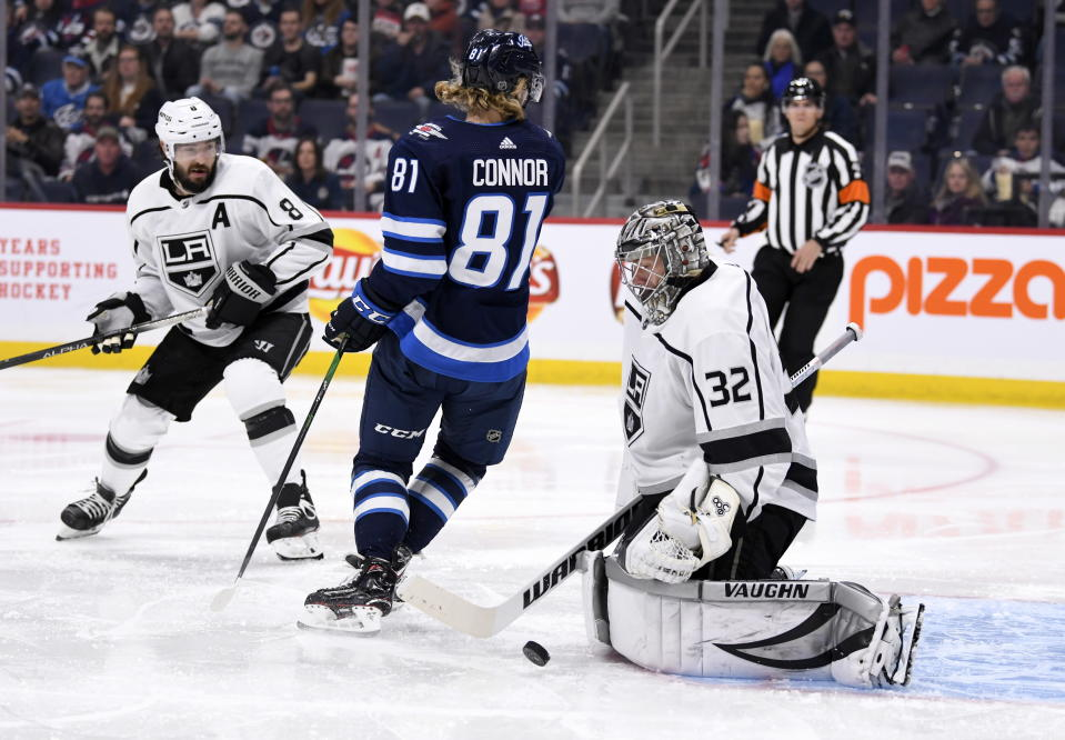 Los Angeles Kings goaltender Jonathan Quick (32) makes a save as Winnipeg Jets' Kyle Connor (81) looks back for the rebound during the second period of an NHL hockey game Tuesday, Oct. 22, 2019, in Winnipeg, Manitoba. (Fred Greenslade/The Canadian Press via AP)