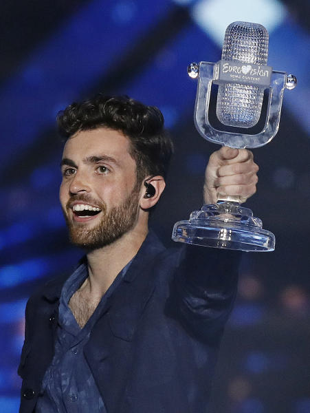 "Duncan Laurence of the Netherlands celebrates with the trophy after winning the 2019 Eurovision Song Contest grand final with the song ""Arcade"" in Tel Aviv, Israel, Saturday, May 18, 2019. (AP Photo/Sebastian Scheiner)"