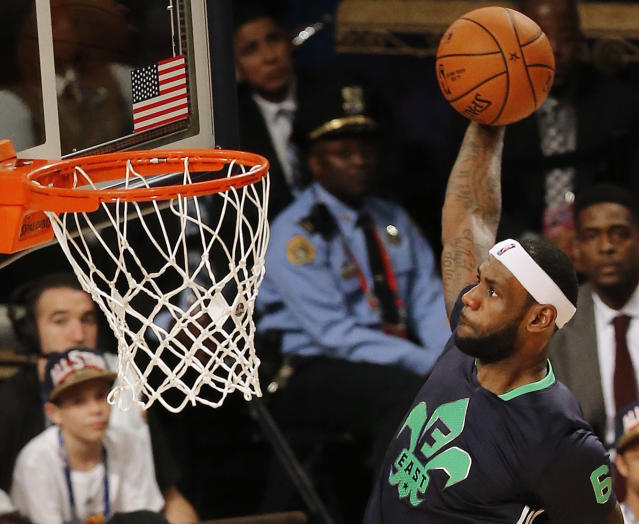 East Team's LeBron James, of the Miami Heat (6) heads to the hoop during the NBA All Star basketball game, Sunday, Feb. 16, 2014, in New Orleans. (AP Photo/Bill Haber)