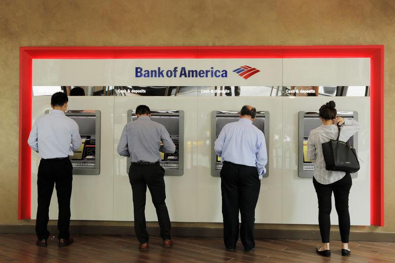 People withdraw money from Bank of America ATMs in New York
