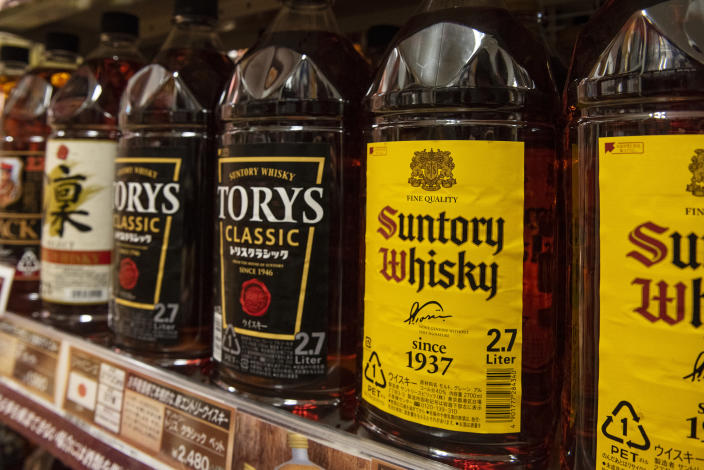 JAPAN - 2019/12/23: Japanese alcoholic brand, Suntory Whisky seen at a supermarket in Tokyo. (Photo by Budrul Chukrut/SOPA Images/LightRocket via Getty Images)