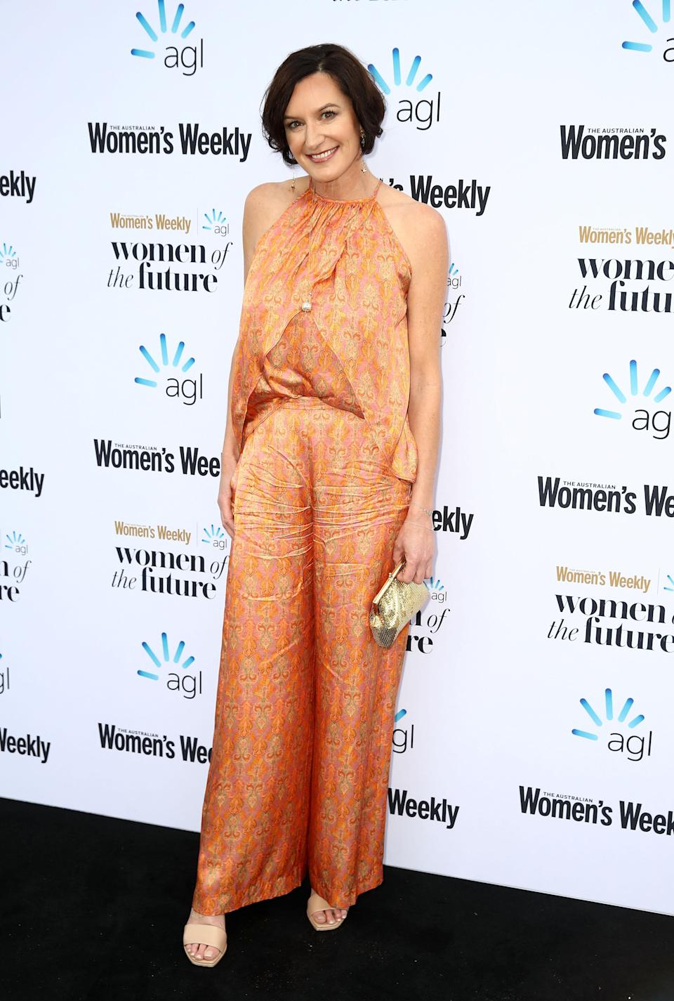 She arrived at the Quay in a stunning orange jumpsuit. Photo: Getty