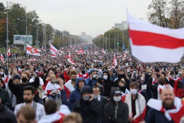People attend an opposition rally in Minsk in September 2020 to protest the presidential election results and the inauguration of Lukashenko.