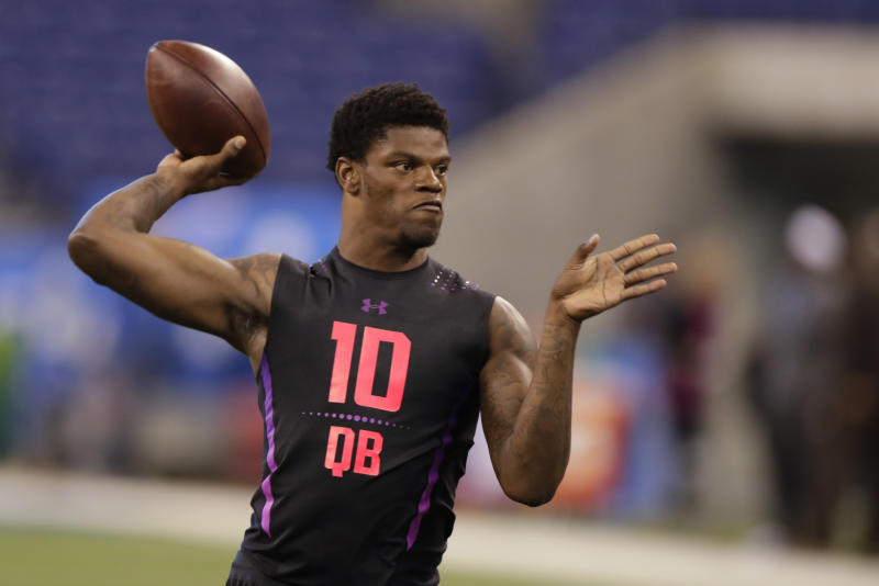 Louisville quarterback Lamar Jackson runs a drill at the NFL scouting combine in Indianapolis. (AP)