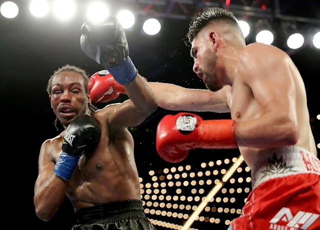 Jose Ramirez (R) took his record to 22-0, as he captured the vacant World Boxing council super lightweight title with a 12-round unanimous decision over fellow American Amir Imam (R) (AFP Photo/Abbie Parr)