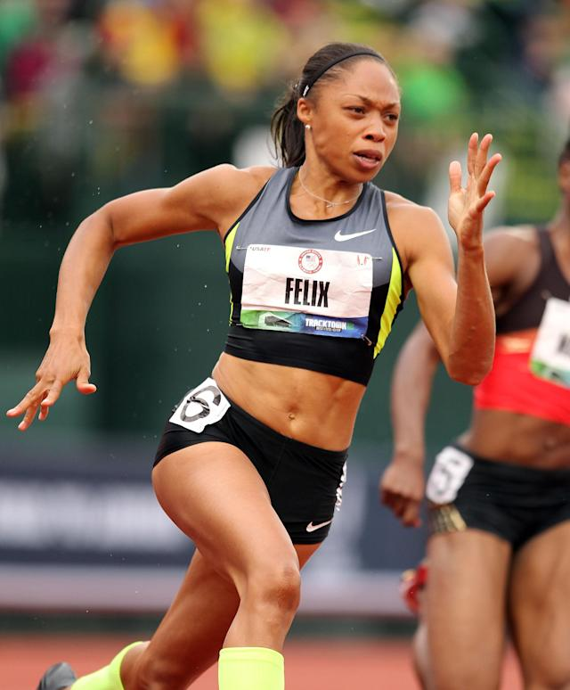 EUGENE, OR - JUNE 30: Allyson Felix runs to victory in the Women's 200 Meter on Day 9 of the 2012 U.S. Olympic Track & Field Team Trials at Hayward Field on June 30, 2012 in Eugene, Oregon. (Photo by Andy Lyons/Getty Images)