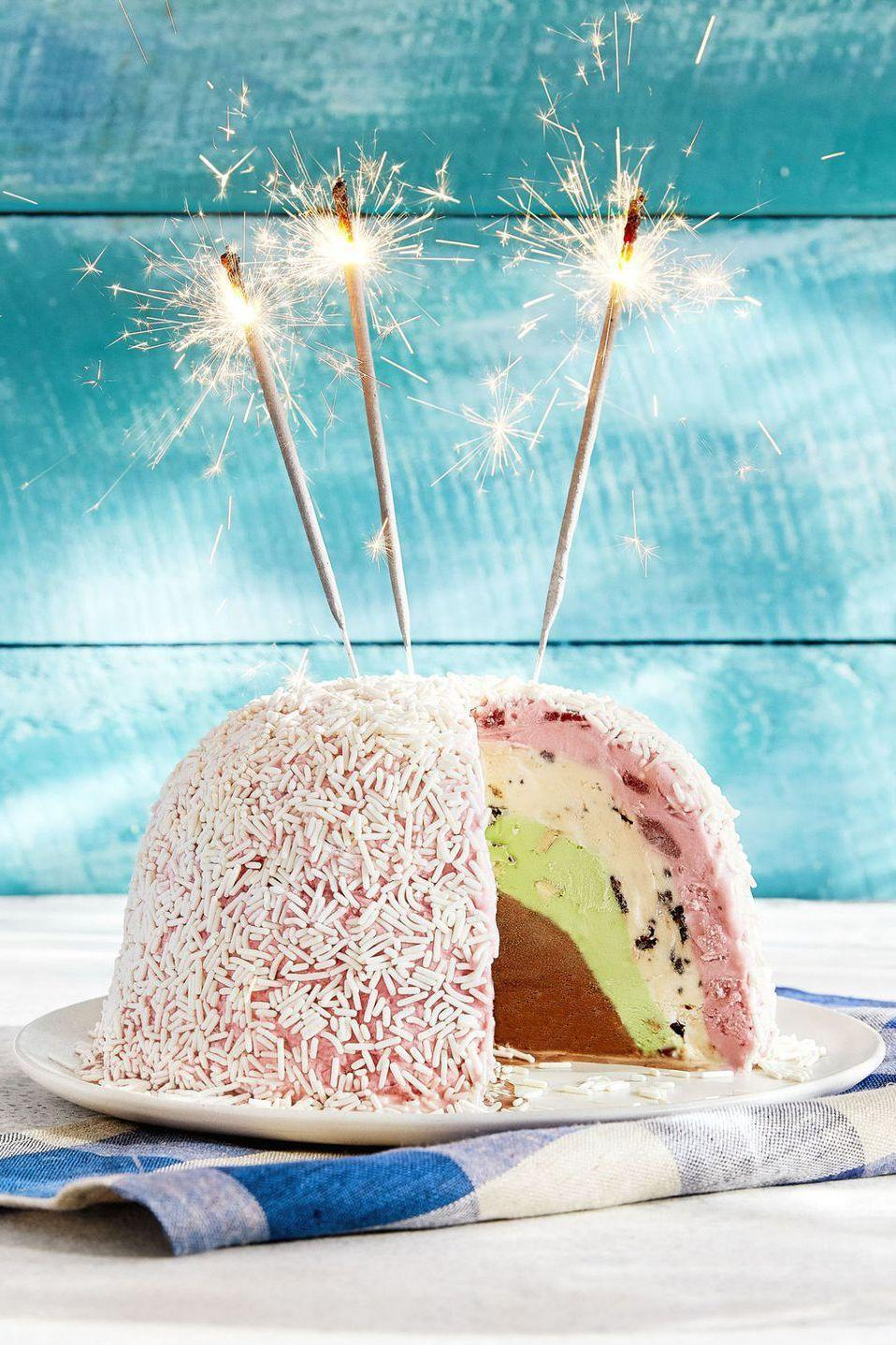 """<p>Why serve your cake with a side of ice cream when you can have four layers of what you <em>really</em> want? And to top it all off, this recipe calls for sprinkles and sparkler candles.</p><p><em><a href=""""https://www.countryliving.com/food-drinks/recipes/a43073/blue-bell-ice-cream-bombe-recipe/"""" rel=""""nofollow noopener"""" target=""""_blank"""" data-ylk=""""slk:Get the recipe from Country Living »"""" class=""""link rapid-noclick-resp"""">Get the recipe from Country Living »</a></em></p><p><strong>RELATED: </strong><a href=""""https://www.goodhousekeeping.com/appliances/ice-cream-maker-reviews/g258/best-ice-cream-makers/"""" rel=""""nofollow noopener"""" target=""""_blank"""" data-ylk=""""slk:9 Best Ice Cream Makers for Easy At-Home Sundaes"""" class=""""link rapid-noclick-resp"""">9 Best Ice Cream Makers for Easy At-Home Sundaes</a><br></p>"""
