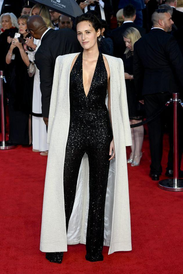 Phoebe Waller-Bridge dazzles in a beaded black jumpsuit with a glittering white cape. (Photo: Dave J Hogan via Getty Images)