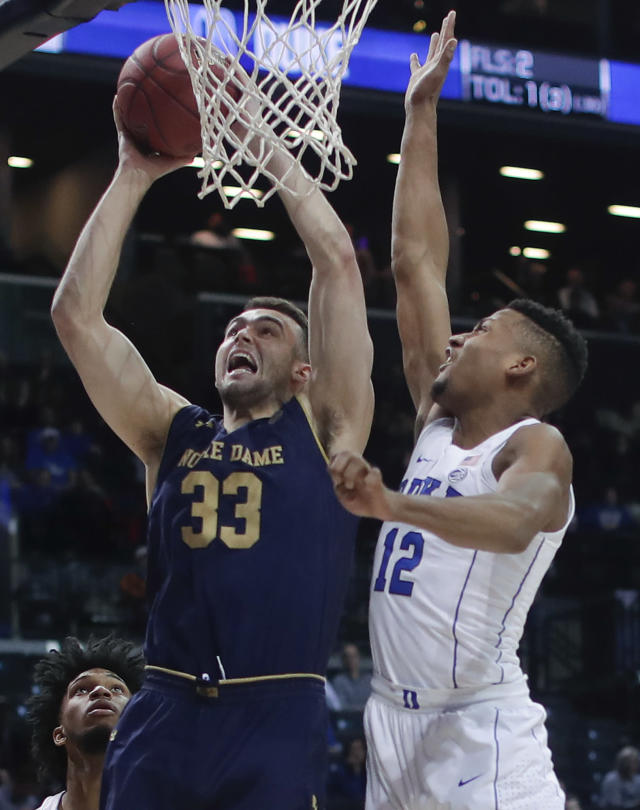 Notre Dame forward John Mooney (33) shoots against Duke forward Javin DeLaurier (12) during the first half of an NCAA college basketball game in the Atlantic Coast Conference men's tournament Thursday, March 8, 2018, in New York. (AP Photo/Julie Jacobson)