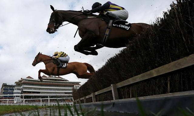 "<span class=""element-image__caption"">A general view as runners clear the water jump at Newbury, where they race on Friday.</span> <span class=""element-image__credit"">Photograph: Alan Crowhurst/Getty Images</span>"