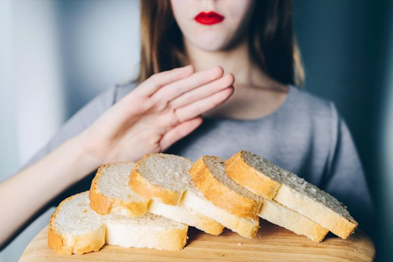 Woman refuses to eat white bread. Shallow depth of field