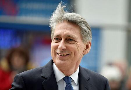 FILE PHOTO:Britain's Chancellor of the Exchequer Philip Hammond  arrives at the National Cyber Security Centre in London