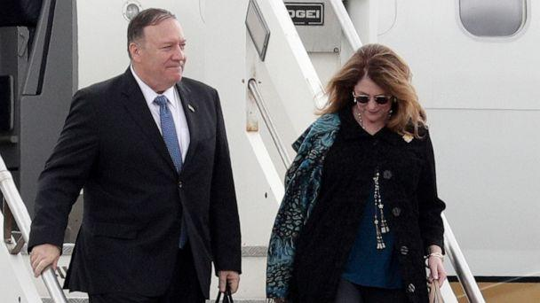 PHOTO: Secretary of State Mike Pompeo and his wife Susan Pompeo walk out of the plane upon arriving at Ciampino military airport, in Rome, Oct. 1, 2019. (Andrew Medichini/AP)