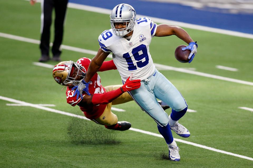 Dallas Cowboys wide receiver Amari Cooper (19) is tackled by San Francisco 49ers defensive back Tarvarius Moore (33) in the fourth quarter at AT&T Stadium.