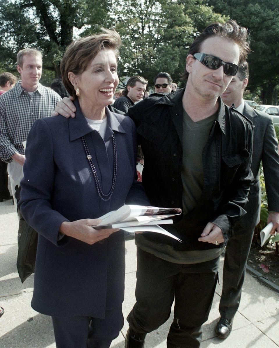 <p>Pelosi and Bono walk around Capitol Hill after a press conference on third world debt relief. </p>