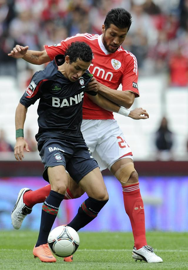 Benfica's Spanish defender Ezequiel Garay (R) vies with Maritimo's midfielder Danilo Dias (L) during a Portuguese football mach at Luz Stadium in Lisbon on April 21, 2012. AFP PHOTO/ FRANCISCO LEONG (Photo credit should read FRANCISCO LEONG/AFP/Getty Images)