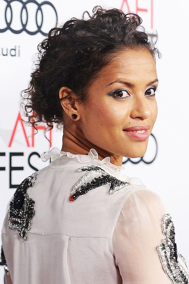 <p>Mbatha-Raw pulls her curls back in a low bun. </p>