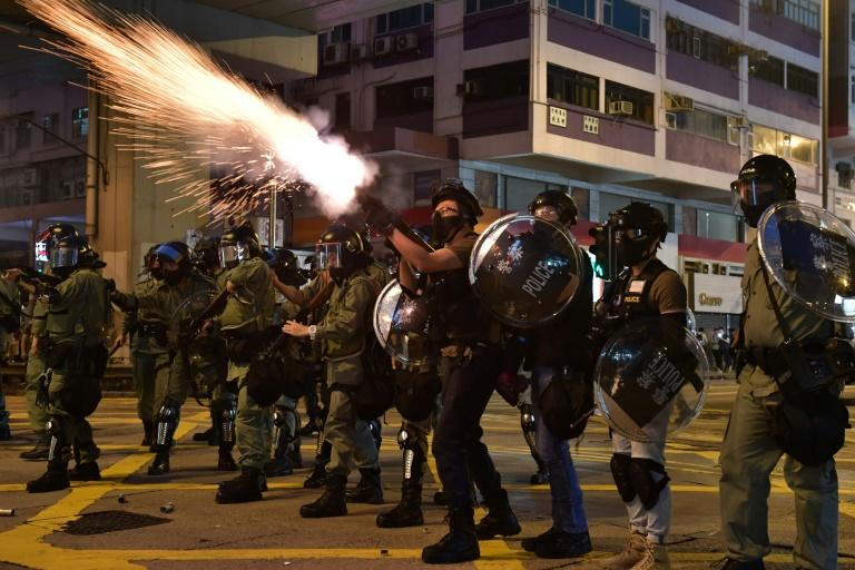 Hong Kong police fired repeated volleys of tear gas and used rubber bullets and baton charges