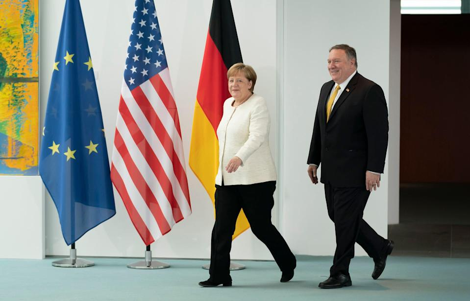 BERLIN, GERMANY - MAY 31: German Chancellor Angela Merkel (L) and U.S. Secretary of State Mike Pompeo chat prior to giving statements to the media before talks at the Chancellery on May 31, 2019 in Berlin, Germany. (Photo by Thomas Koehler/Photothek via Getty Images)