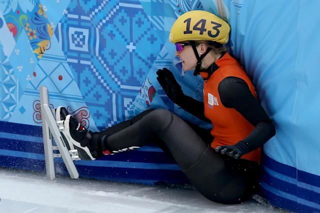 SOCHI, RUSSIA - FEBRUARY 10: Sanne van Kerkhof of Netherlands falls into the wall while competing in the Short Track Ladies' 3000m Relay Semifinal on day 3 of the Sochi 2014 Winter Olympics at Iceberg Skating Palace on February 10, 2014 in Sochi, Russia. (Photo by Matthew Stockman/Getty Images)