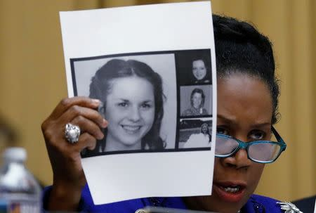 Rep.  Sheila Jackson Lee (D-TX) holds up pictures of women who've accused U.S. Senate candidate Roy Moore of sexual misconduct, while questioning U.S. Attorney General Jeff Sessions (Not Pictured) during  the House Judiciary Committee oversight hearing on Capitol Hill in Washington, U.S., November 14, 2017. REUTERS/Aaron P. Bernstein