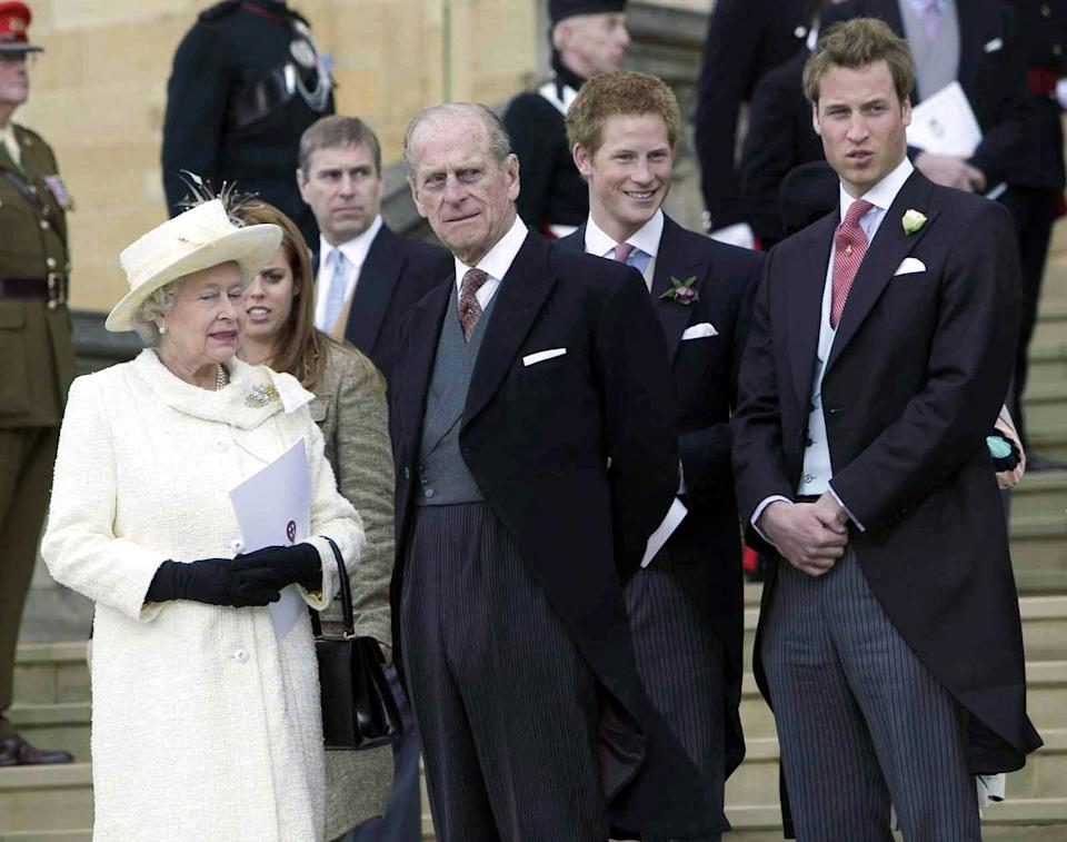 <p>The Queen, Princess Beatrice, the Duke of Edinburgh, Prince Harry and Prince Willam watch as Prince Charles and Camilla, the Duchess of Cornwall meet the public outside St George's Chapel in Windsor after the blessing of their civil marriage, in April 2005. (Bob Collier/POOL/AFP via Getty Images)</p>