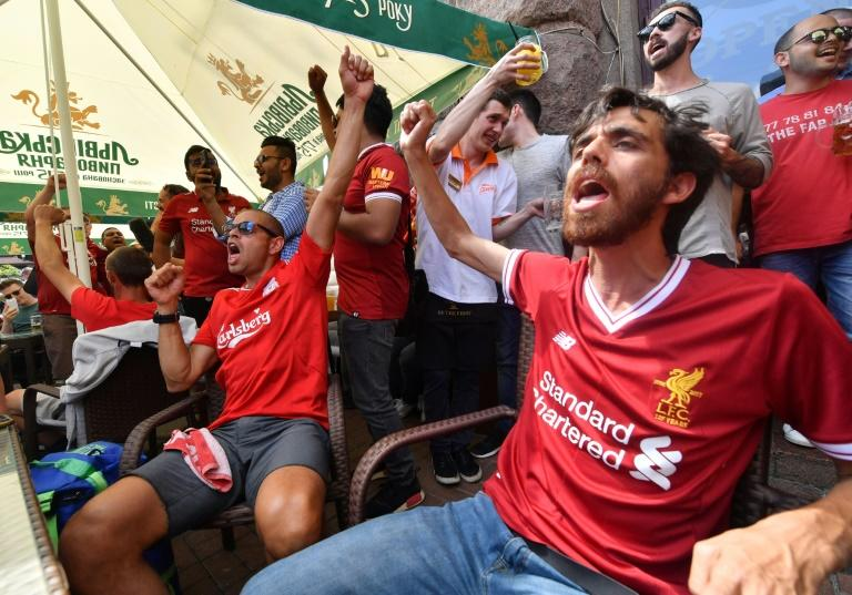 Liverpool fans get into the mood in central Kiev -- but many have found hotels have massively hiked prices for the final