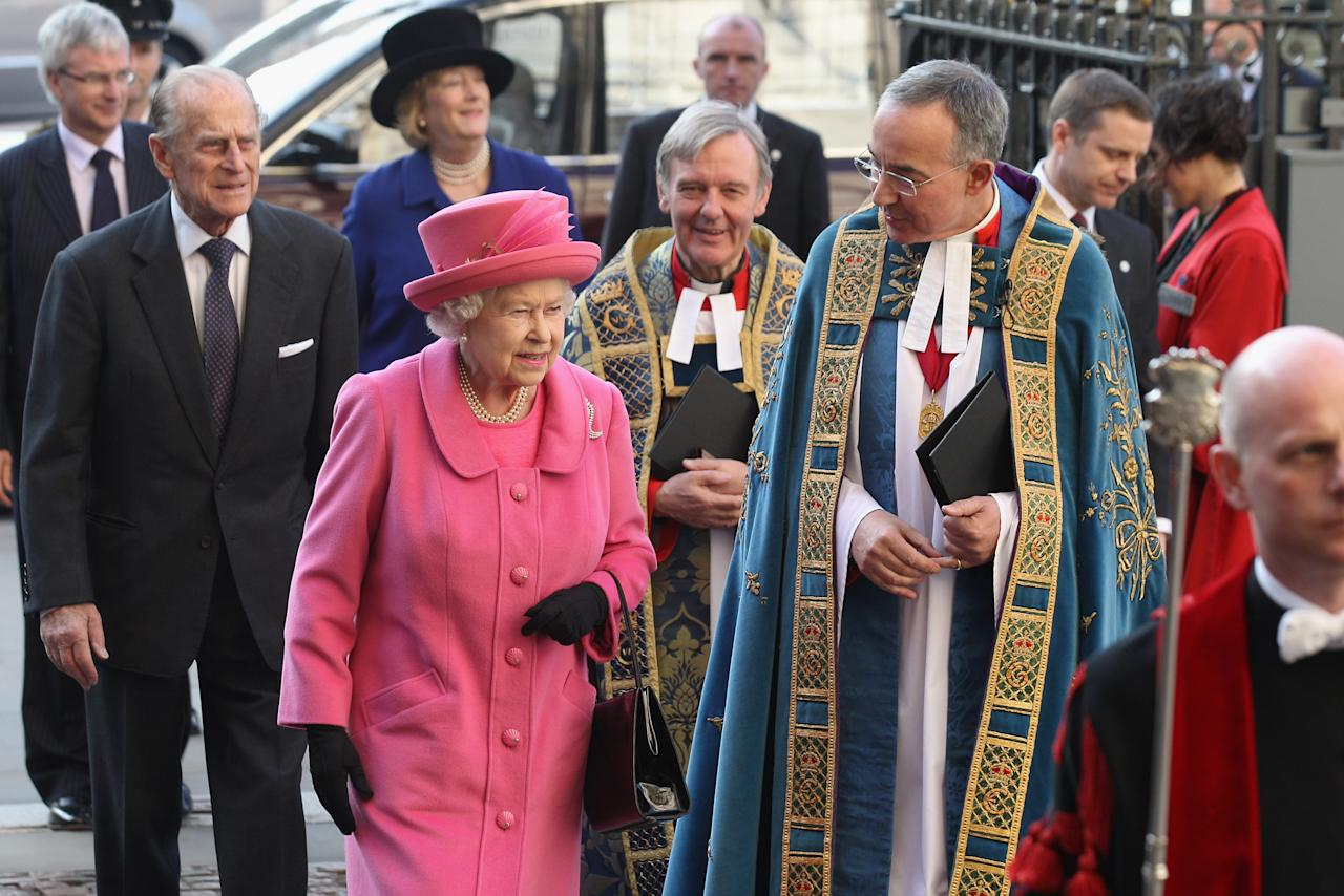 """LONDON, ENGLAND - MARCH 12:  Queen Elizabeth II (4th L) is greeted by the Very Reverend Dr John Hall (4th R), the Dean of Westminster, as she arrives at Westminster Abbey to attend tthe annual Commonwealth Day Observance Service on March 12, 2012 in London, England. The theme for this year's Observance Service, attended by representatives from the Commonwealth countries is """"Connecting Cultures"""". Her Majesty will conduct a Diamond Jubilee tour of the UK between March 8, 2012 and July 25, 2012.   (Photo by Oli Scarff/Getty Images)"""